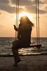 Sunrise swing (Margeaux Nicholas) Tags: beach cellphone checkingin clods dawn dress girl holdaydisplay mexico peaceful phone sunglasses sunrise swing travel vacation woman