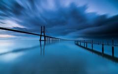 Blue vertigo (marcolemos71) Tags: seascape water hightide bridge pvg concret pontevascodagama sky clouds sunrise storm rain reflection leefilters longexposure lisbon marcolemos