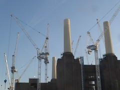Battersea Power Station, London..A Symphony of Cranes.. (Julie Rutherford1 ( off/on )) Tags: battersea power station london cranes chimneys conversion sky nine elms south bank river thames