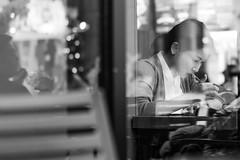 Working and Coffee (frank.gronau) Tags: reflexion reflection window work working girl woman frau starbucks white black weis schwarz coffee café alpha sony gronau frank