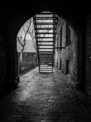 Hideout (michaelwalker19) Tags: doorway staircase blackandwhitechurch blackandwhitecleveland blackandwhite brickwall wet downtowncleveland