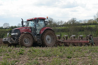 Case IH Puma 230 CVX Tractor with a Kverneland 5 Furrow Plough