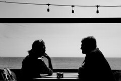 Let's Talk [ In Explore 15-05-2018 ] (sawyersource) Tags: streetphotography street blackwhite blackandwhite bw people barcelona hand unsuspecting candid lights beach beachview bnw bnwstreet restaurant lowiso silhouette talking pondering talk couples couple spain catalan gestures bodylanguage samsung samsungs9 mobilestreet mobilestreetphotography mobilephoto minimalism sea sky españa catalunya monochrome mono