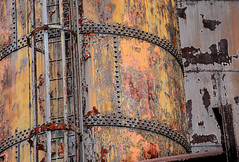 Corroded Steel Tank - Bethlehem Steel Plant (JohnColeUSA) Tags: bethlehemsteelplant bethlehemsteelmill bethlehempa usa abandoned bethlehemironworks bethlehemsteelworks decayed deteriorating discolored geometric industrial metal rust stained steelmill steelprocessing texture urban lehighvalley lehighcounty round curved yellow colorful
