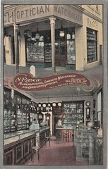 N. Rasch - jeweller and optician in Warwick, Qld - circa 1910 (Aussie~mobs) Tags: queensland australia vintage advertisement advertisingpostcard jeweller watchmaker optician store shop interior warwick nrasch