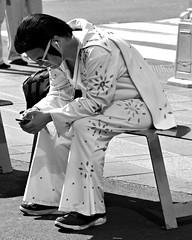0915024 (kzzzkc) Tags: nikon d7100 usa newyork city nyc manhatten bw candidportrait timessquare elvis impersonator bench onthephone