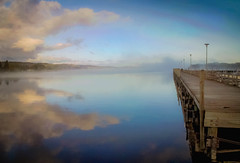 Reflections of the Morning (T P Mann Photography) Tags: reflections morning eastjordan breezeway michigan lake clouds sky dock pier fog mist atmosphere sunrise dawn cold