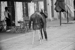 Leather Jacket (03mod) (AngusInShetland) Tags: navigli canal leather jacket leatherjacket photographer shops italy milan milano minoltadynax7000i berggerpancro400 35mm film fashion