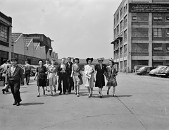 Workers coming out of the Highland Park Chrysler plant. Detroit, Michigan. Spring, 1942. (polkbritton) Tags: arthursiegel 1940s vintagecars vintagefashion wwii wwiihomefront worldwarii workers detroithistory fsaowi libraryofcongresscollections