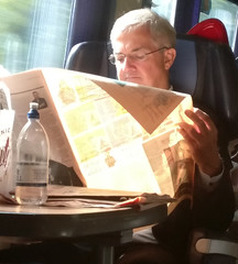 faster by train anyway (n.a.) Tags: chris huhne celebrity uk politician reading newspaper pret train glasses energy secretary convict