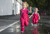 Children play on the street after the rain in pink bright rubber boots. The rays of the sun are reflected in the drops of water (Galina Niederhaus) Tags: rain child puddle fun water boots wet kid spring weather park dirty rubber jump autumn rainy young play girl happy splashing childhood funny little nature splash walk dirt summer messy happiness playful toddler people season umbrella cheerful cute fall joy red rainboots outdoor pool pink day beautiful green baby female