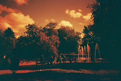 lc-a+ - jephson gardens redscale (johnnytakespictures) Tags: lomo lomography redscale redscalexr photo photography film analogue lca leamingtonspa leamington warwickshire orange red jephsongardens jephson gardens park nature natural fountain river canal stream goose geese bird birds waterfeature water