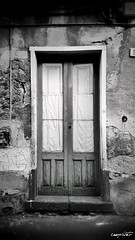 old doors (Massimo Vitellino) Tags: olddoors outdoors wall structure architecture house hdr blackandwhite abstract contrast conceptual perspective lights shadows noperson city
