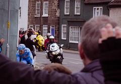 The leader (barronr) Tags: england knaresborough rkabworks tourdeyorkshire yorkshire bathgatephotographer control cycling cyclists male man motorbike race