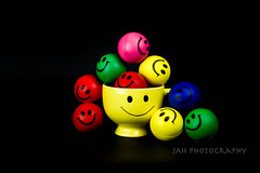 Smile In The Darkness (jah32) Tags: smilie smile happy happyface colour color colours colors colourful black negativespace stilllife tabletop table onthetable dark darkness happyhappyjoyjoy