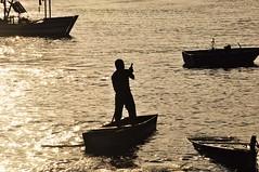 cercado por ouro (Ruby Ferreira ®) Tags: river rio litoralpaulista fisherman pescador barcos boats