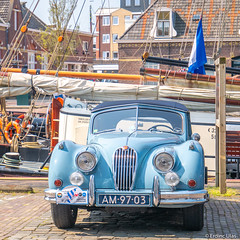 Oldtimer (✦ Erdinc Ulas Photography ✦) Tags: oldtimer car auto old retro oldschool netherlands dutch holland jaguar blue gray chrome flag boat ship sail friesland harlingen rope wheel focus panasonic fries nederland city classic lamp houses roof brick detail
