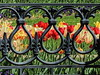Spring Fence (clarkcg photography) Tags: fence tulips iron ornate curves imperial fleurdelis loops noose lines red yellow green spring fencedfriday threeloops florafriday fridayflora 7dwf