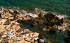 CAPRI (paologmb) Tags: umbrellas rock fun magnum capri discover italy gold 135mm perspective sea blue contrast hot leicamtyp240 summer beach nationalgeographic vertigo leicaapotelytm135mm