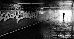 Wet underground (Leonegraph) Tags: mann men reflection rain wet tunnel underground kontrast contrast gegenlicht shadow schatten silhouette leonegraph streetphotographer streetphotography story urban spontan spontanious candid unposed human street 2018 europe germany deutschland city stadt monochrome bw blanco negro bn sw schwarz weis black white panasonicgx80 panasonic1235mmf28 mft microfourthirds hannover hanover