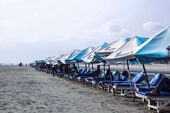 Somewhere on the Cox's Bazaar beach. (Mohammad Iftekharul Hasan) Tags: coxsbazar bangladesh beach beachumbrella sand arrangement sky iftekharhasan
