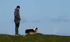 Rumbled (RoystonVasey) Tags: canon eos 400d 70300mm usm zoom northumberland coast dunstanburgh castle man dog border collie