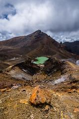 Volcanic Scree (Nikhil Ramnarine) Tags: newzealand northisland tongariro tongarirocrossing mountain emeraldlake lake rock scree clouds travel nikon d500
