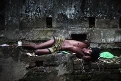 An Eye For An Arm (N A Y E E M) Tags: youngman retard disabled sleep colors friday afternoon wall street sarsonvalley chittagong bangladesh carwindow
