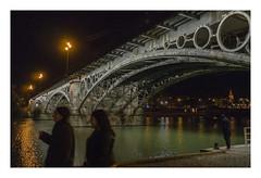 Puente de Isabel II (Sevilla) (AurelioZen) Tags: europe spain andalusia sevilla triana puentedetriana puentedeisabelii castironbridge people lowlightcity gustavosteinacherferdinandbennetot