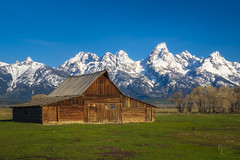 Moulton Blue (RobertCross1 (off and on)) Tags: 20mmf17panasonic antelopeflats em5mkii grandteton grandtetonnationalpark jackson jacksonhole moose mormonrow moultonbarn mountainwest omd olympus rockymountains tetons wy wyoming architecture barn bluesky fence grass landscape snow trees