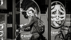 surprise! (Gerard Koopen) Tags: belgië antwerpen antwerp city surprise eyecontact woman people poster bike candid streetlife straat street straatfotografie streetphotography blackandwhite noir blackandwhiteonly fujifilm fuji xpro2 35mm 2018 gerardkoopen gerardkoopenphotography