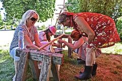 milking training (t.horak) Tags: milking milk 70s retro farming women farmer work red dress boots village czech