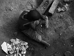 DESTINY (Genius Wizard) Tags: child poor street slum play gamebricks blackandwhite