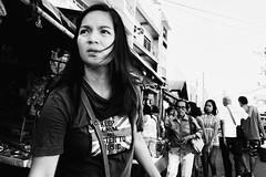 Keep Calm and Listen to Music (Meljoe San Diego) Tags: meljoesandiego ricoh grd4 grdiv streetphotography people candid monochrome alaminoscity philippines