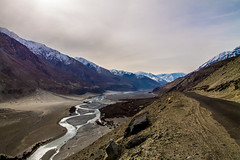 a road, a river and mountains (Mijan Rashid) Tags: india indiansubcontinent asia asian bangladeshi blue canon canon1100d clouds cloud cloudy canon1100 day frozen himalayas himalaya hills ice jammukashmir jammu kashmir landscape ladakh leh land lines nature nubravalley mountain mountains march2017 morning outdoor photography river rocks road southasia sky sun snow tamron tamron18270mm travel tamron18270 travelphotography 1100d 18270mm