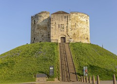 Clifford's Tower in the dawn light. (jack cousin) Tags: 13thcentury british clifford'stower england uk york yorkshire ancient architecture attraction bluesky cloud daytime embankment exterior fort grass green height heritage hillock historic history icon iconic incline landmark localicon medieval monument mound old outdoor placeofinterest remains ruin ruins sky stone stonework sunny tourism touristattraction tower travel nikond610 on1photos