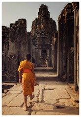 A step towards enlightenment (Johnbasil1) Tags: asia travel temple heat glow warm soft orange journey ancient monk angkorthom angkor bayontemple