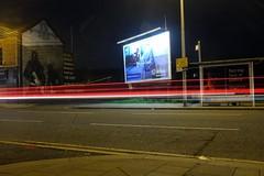 Vroooom (Moochin Photoman) Tags: belfast northernireland muralandbillboard thegiftthatkeepsgiving night ndfilter longexposure f11forthenerds