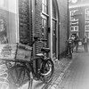 Old Bikes and Young People (Of Light & Lenses) Tags: holland leiden stadtausflug bikes oldbikes youngpeople cityscape bw blackandwhite schwarzweiss university 1575 viez bycicle transpotbike timehonoured olympus mzuiko südholland southholland m1240 f28