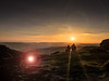 Sunset on Higger Tor (Waving lights in the dark) Tags: iphone sunset silhouette people strangers flare lensflare sun warm