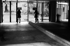 Entering the garden (pascalcolin1) Tags: paris femme woman glace miroir mirror reflets reflection hall jardin garden lumière light ombre shadows photoderue streetview urbanarte noiretblanc blackandwithe photopascalcolin 5omm canon50mm canon