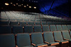 Sumner M. Redstone Theater (Zach K) Tags: theater sumner m redstone musuem moving image museumofthemovingimage queens astoria nyc learning film movies theather dark seats seating rows aqua fabric viewing pictures astoriaqueens fujifilm fuji xt1 23mm empty