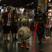 Cosplayer family clad as Jedi, Sith and BB-8 robot