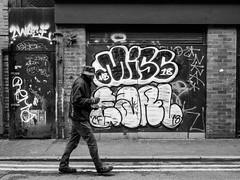 Northern Quarter 205 (Peter.Bartlett) Tags: manchester niksilverefex people city graffiti candid walking urbanarte door peterbartlett hat man urban streetphotography monochrome uk m43 microfourthirds olympuspenf bw noiretblanc wall blackandwhite facade bottle england unitedkingdom gb