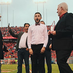 Junior philosophy major Victor Eduardo, center, reacts after being named NC State's 2017 Leader of the Pack during the Homecoming football game on Nov. 4.