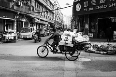 Goodbye Lin'an (Go-tea 郭天) Tags: linan hangzhou old woman lady busy work working duty business transportation transport traditional ride riding bicycle bike tricycle papers movement slow hard sun sunny recycle recycling shadow poor money green alone lonely road cars motorbike motorcycle cable electric electricity street urban city outside outdoor people candid bw bnw black white blackwhite blackandwhite monochrome naturallight natural light asia asian china chinese canon eos 100d 24mm prime