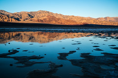 Salty Puddle at Sunrise (Kurt Lawson) Tags: alpenglow death deathvalley flat flats mountains mud national panamint park puddle range reflection salt sunrise valley water