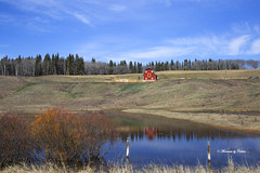 Red Barn on the Hill (Canon Queen Rocks (2,082,000 + views)) Tags: bluesky blues building barn grass pond red reflections reds shrubs trees landscape landscapes sky scenery scenic alberta farm farmland clouds colours canada