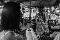 The purchase (aliwton) Tags: ifttt 500px commerce stock merchant sell man incidental people woman black white monochrome noir leica hybrid film digital silver gelatin street urban candid casa amarela recife pernambuco brazil brasil south america latin money currency