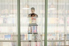 Manga section (AntEater Theater) Tags: books bookstores reflections underground eslite browsing glass windows bookshops taipei taiwan streetphotography